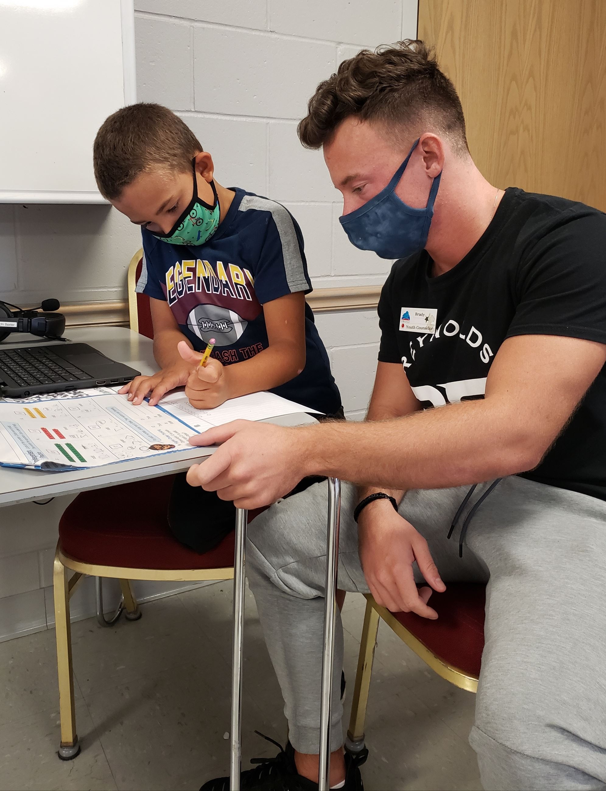 Youth Counselor helps student with homework